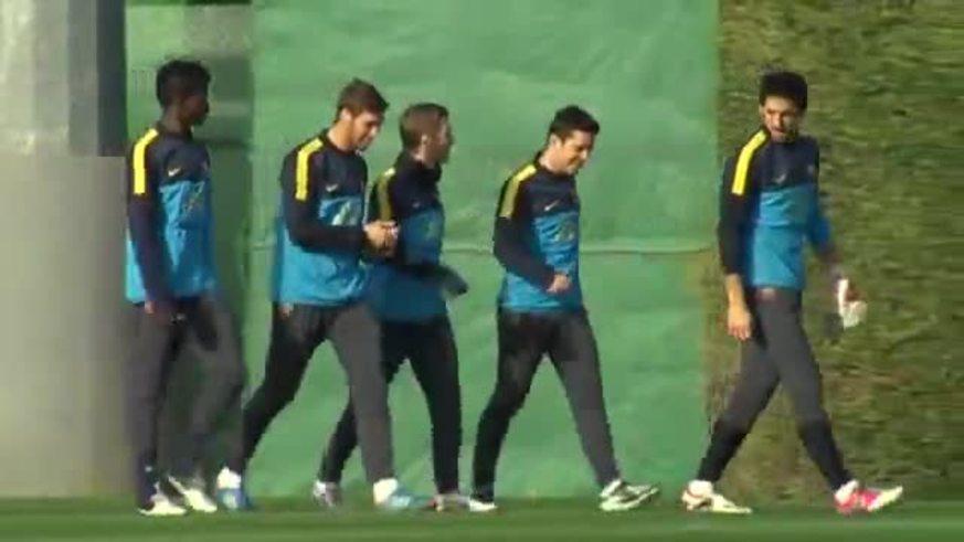 Verón y Messi en la práctica del Barsa.
